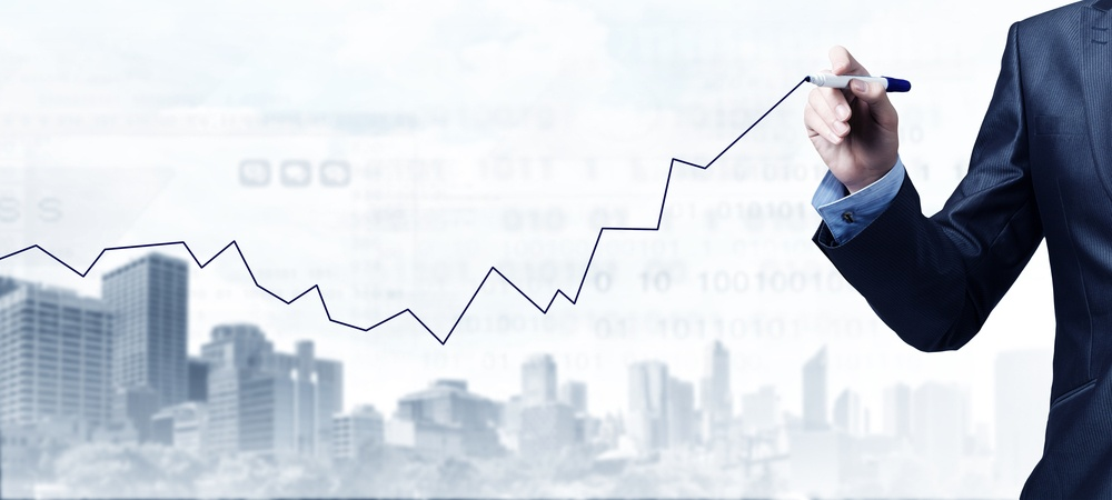 Close up of businessman drawing increasing graph with marker.jpeg