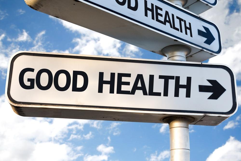 Good Health direction sign on sky background.jpeg