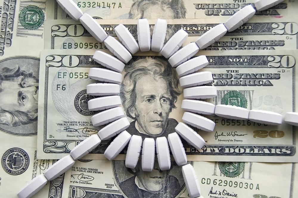 Ring of light-colored tablets on U.S. $20 bills.jpeg
